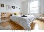 bright-bedroom-wooden-floor-simple-260nw-1683655276